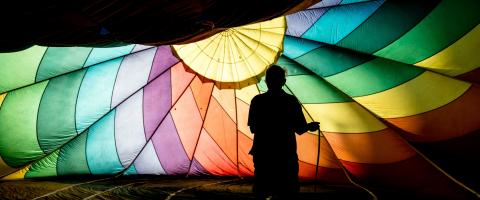 Person Holding a colorful Parachute