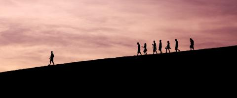 People walking down a hill