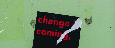 "Sticker with the words ""Change is Coming"""