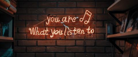 "sign on the wall ""you are what you listen to"""