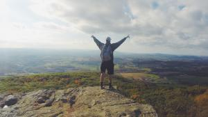 Man standing in Top of a Mountain