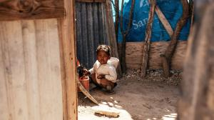 Small child inside of a home in a poor area