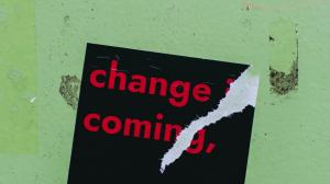 """Sticker with the words """"Change is Coming"""""""