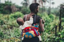 Woman Carrying Baby