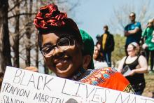 Woman holding a Black Lives Matter Sign