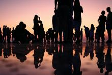 People standing together during sunset