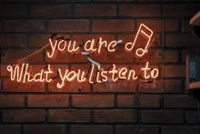 """sign on the wall """"you are what you listen to"""""""