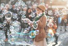 woman joyful with bubbles